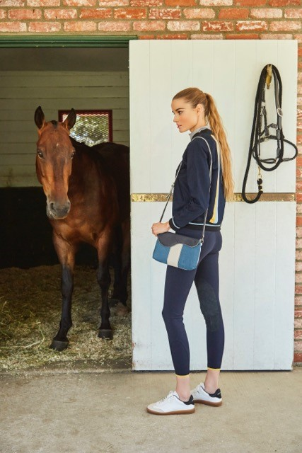 Outfit: Team Jacket in navy and The C Breeches in navy by Callidae available at callidae.com Bag: Oughton, Paddock Crossbody Clutch in turquoise available at www.oughtonlimited.com Shoes: Isabel Marant Etoile, Bryce Sneakers available at FWRD.com