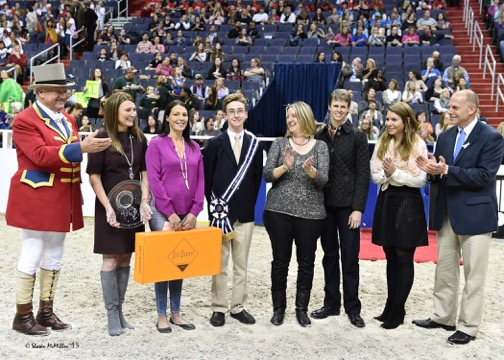Bailey being presented with the WIHS Laura Pickett Trophy. Photo by Shawn McMillen Photography