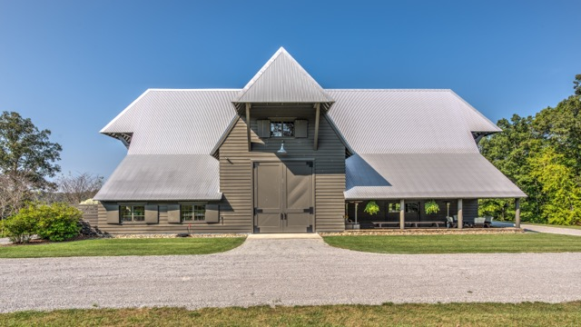 Bobby McAlpine designed this barn outside of Nashville, Tennessee, for clients who wanted living space as well as entertaining areas that could accommodate large parties. Photo by Bruce Cain of Elevated Lens Photography