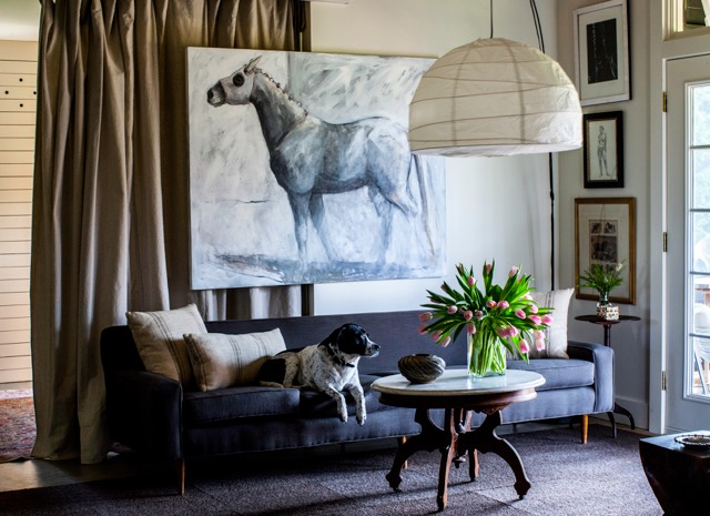 The living room in Lida's home — which is connected to her two-stall barn — reflects her love for horses. Photo by Kris Kendrick