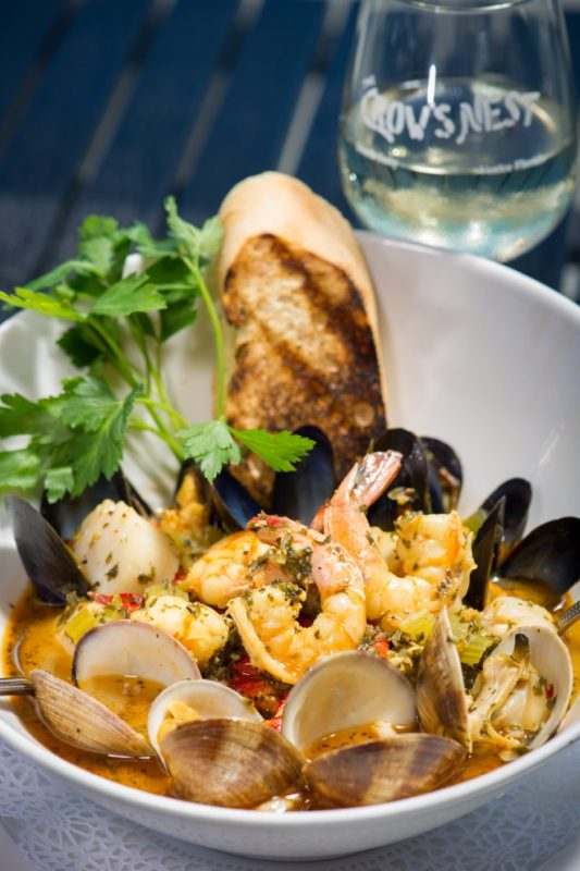 Bouillabaisse and a glass of wine make for the perfect evening.