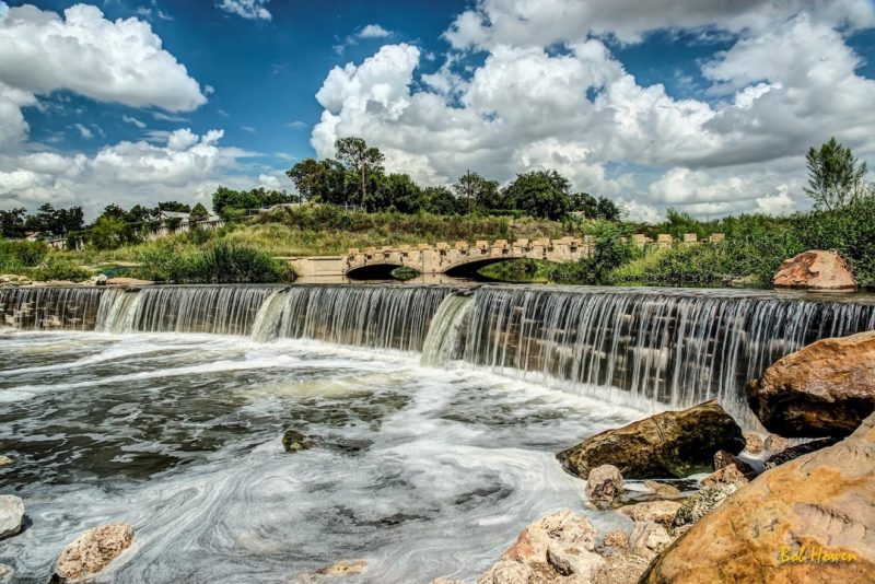 The River Walk includes beautiful stone bridges and waterfalls. Photo courtesy of VisitSanAntonio.com, photographer Bob Howen