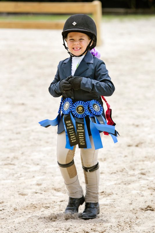 A young rider is all smiles during a Fox Lea Farm horse show. Photo by Victoria DeMore